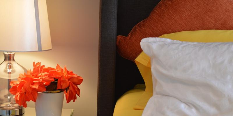 Bedroom with lamp and nightstand. Interstate Pest Management serving Portland OR & Vancouver WA talks about bed bugs.