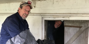 Pest control technicians installing vapor barrier in crawl space. Interstate Pest Management serving Portland OR & Vancouver WA talks about Giving Back to Our Community.