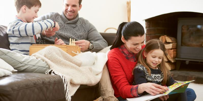 Family looking happy and comfy in their home. Interstate Pest Management serving Portland OR & Vancouver WA talks about 5 Ways to Prepare Your Home for the Winter.